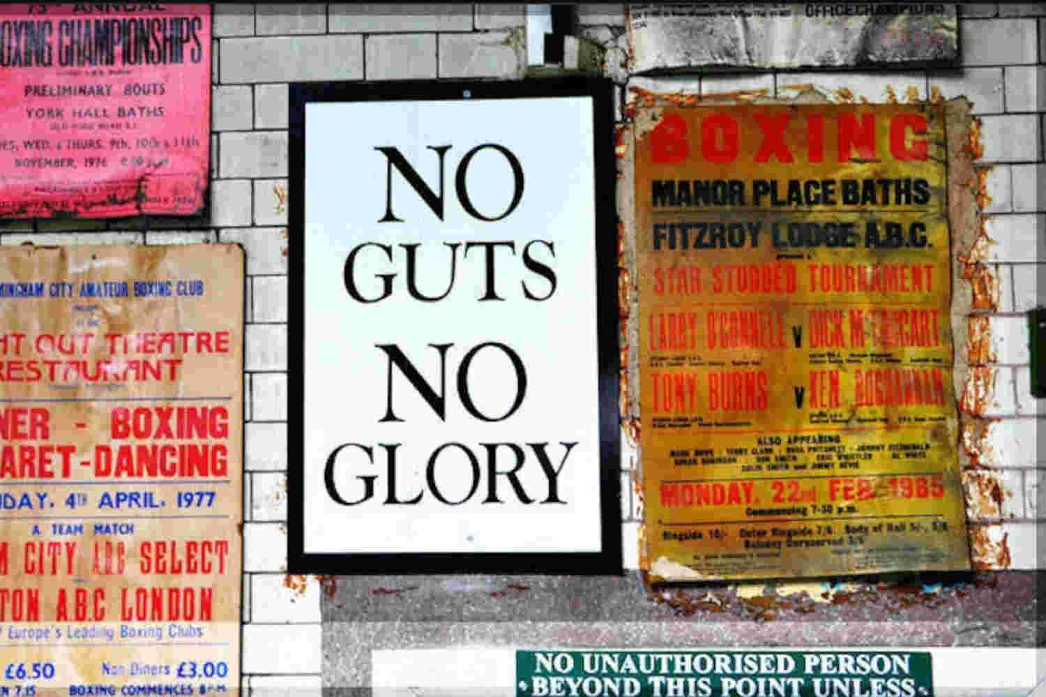 """Sign from inside Repton Boxing Club bearing the club's motto """"No Guts, No Glory"""""""