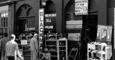 Customers browsing the front of Blackman's Shoes, Cheshire Street
