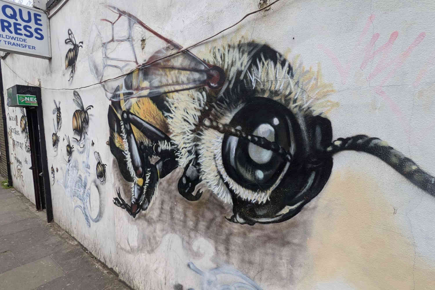 Mural of flying bees on the side of a wall off Bethnal Green Road