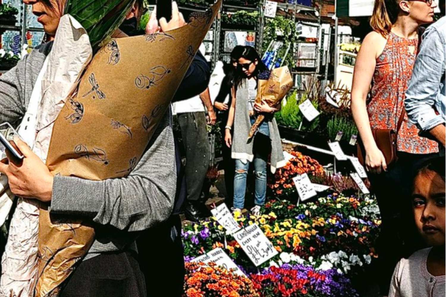 A woman surrounded by flowers at Columbia Road Market