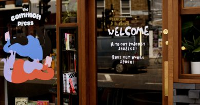 Shop front of The Common Press Bookshop, which 'welcome' graphic and illustration of womxn reading books. Brick Lane.